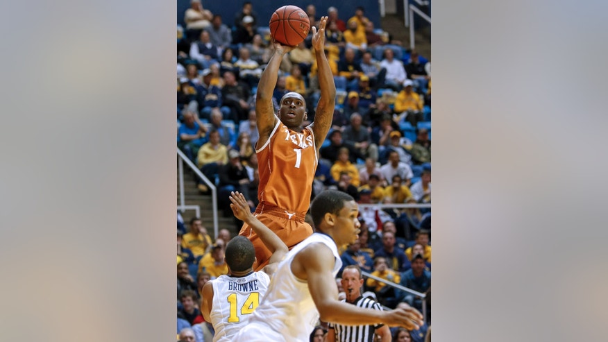Texas' Sheldon McClellan (1) shoots over West Virginia's Gary Browne (14)during the first half of an NCAA college basketball game at WVU Coliseum in Morgantown, W.Va., on Monday, Feb. 4, 2013. (AP Photo/David Smith)