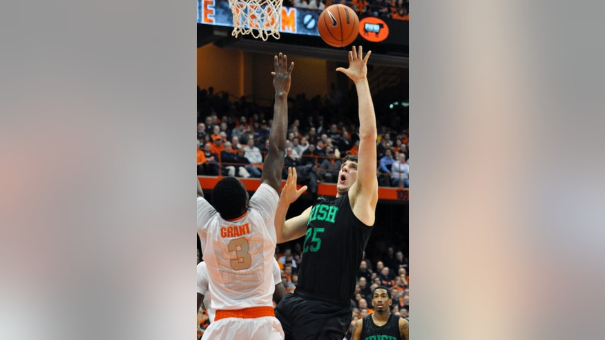 Notre Dame's Tom Knight scores over Syracuse's Jerami Grant during the first half of an NCAA college basketball game in Syracuse, N.Y., Monday, Feb. 4, 2013. (AP Photo/Kevin Rivoli)
