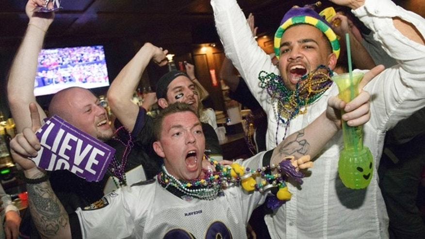 Feb. 3, 2013: Lee Fuller, of Baltimore, center, and others celebrate the Baltimore Ravens winning the Super Bowl at the Famous Door Bar as fans of the Ravens and San Francisco 49ers NFL football teams pack the French Quarter on Bourbon Street for Super Bowl XLVII in New Orleans.