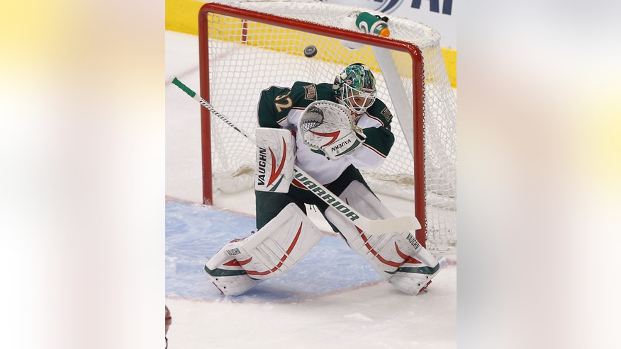 Minnesota Wild goalie Niklas Backstrom, of Finland, blocks a shot against the Phoenix Coyotes during the first period of an NHL hockey game, Monday, Feb. 4, 2013, in Glendale, Ariz. (AP Photo/Matt York)