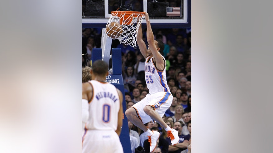Oklahoma City Thunder guard Kevin Martin dunks against the Dallas Mavericks during the second quarter of an NBA basketball game in Oklahoma City, Monday, Feb. 4, 2013. (AP Photo/Alonzo Adams)
