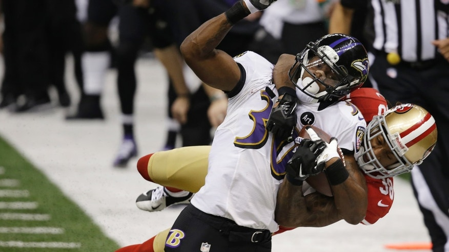 San Francisco 49ers safety Dashon Goldson (38) tackles Baltimore Ravens running back Bernard Pierce (30) during the second half of the NFL Super Bowl XLVII football game, Sunday, Feb. 3, 2013, in New Orleans. (AP Photo/Elaine Thompson)
