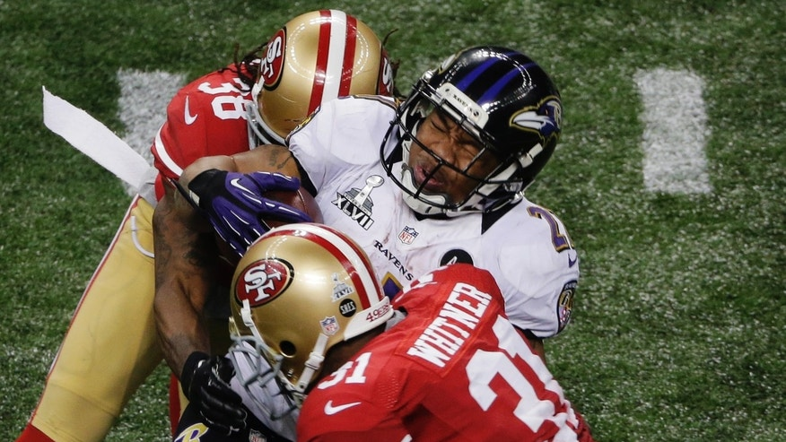 Baltimore Ravens running back Ray Rice (27) is tackled by San Francisco 49ers safety Donte Whitner (31) and safety Dashon Goldson (38) during the second half of the NFL Super Bowl XLVII football game, Sunday, Feb. 3, 2013, in New Orleans. (AP Photo/Charlie Riedel)