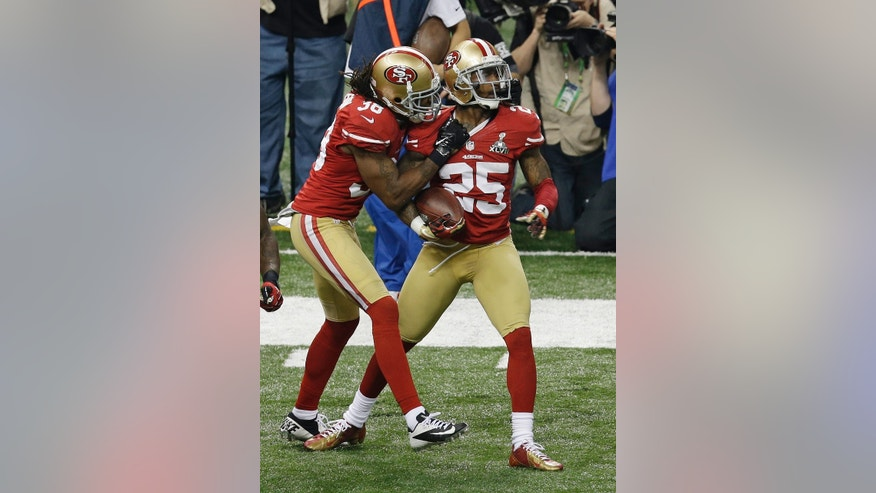 San Francisco 49ers cornerback Tarell Brown (25) celebrates with teammate Dashon Goldson (38) after recovering a fumble during the second half of the NFL Super Bowl XLVII football game against the Baltimore Ravens, Sunday, Feb. 3, 2013, in New Orleans. (AP Photo/Gerald Herbert)