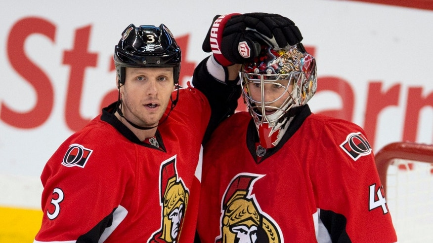 Ottawa Senators defenseman Marc Methot, left, congratulates goalie Craig Anderson after the Senators defeated the Buffalo Sabres 4-3 in an NHL hockey game Tuesday, Feb. 5, 2013, in Ottawa, Ontario. (AP Photo/The Canadian Press, Adrian Wyld)