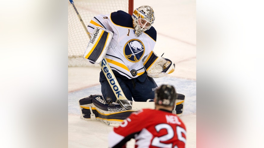 Ottawa Senators right wing Chris Neil takes a shot on Buffalo Sabres goalie Jhonas Enroth during the first period of an NHL hockey game Tuesday, Feb. 5, 2013, in Ottawa, Ontario. (AP Photo/The Canadian Press, Adrian Wyld)