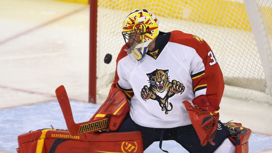 Florida Panthers goaltender Scott Clemmensen is unable to stop a shot by Winnepeg Jets' Blake Wheeler during the second period of an NHL hockey game in Winnipeg, Manitoba, Tuesday, Feb. 5, 2013. (AP Photo/The Canadian Press, Trevor Hagan)