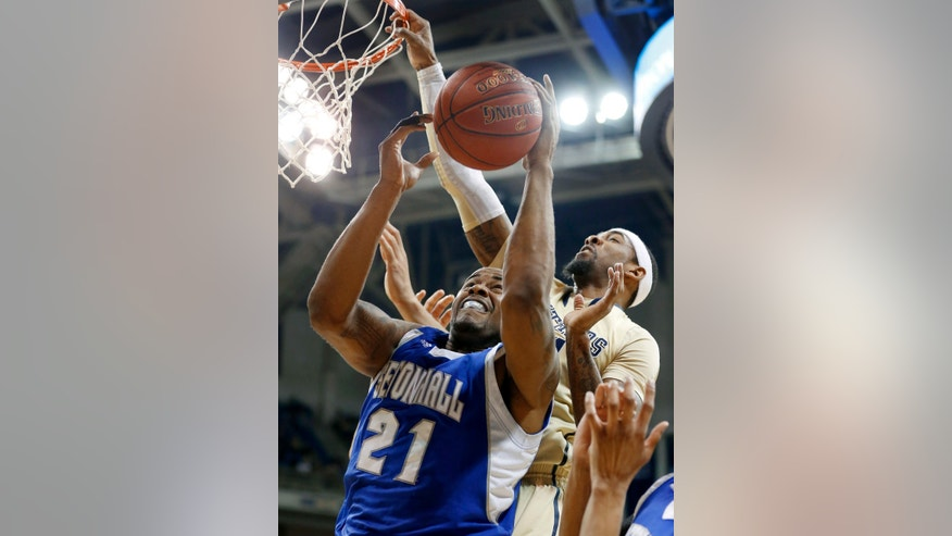 Seton Hall's Eugene Teague (21) gets a rebound on a shot by Pittsburgh's J.J. Moore, right, in the first half of the NCAA college basketball game on Monday, Feb. 4, 2013 in Pittsburgh. (AP Photo/Keith Srakocic)