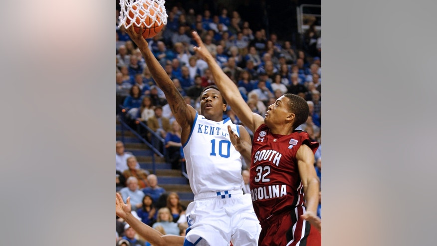 Kentucky's Archie Goodwin (10) shoots next to South Carolina's Damien Leonard (32) during the first half of an NCAA college basketball game at Rupp Arena in Lexington, Ky., Tuesday, Feb. 5, 2013. (AP Photo/James Crisp)