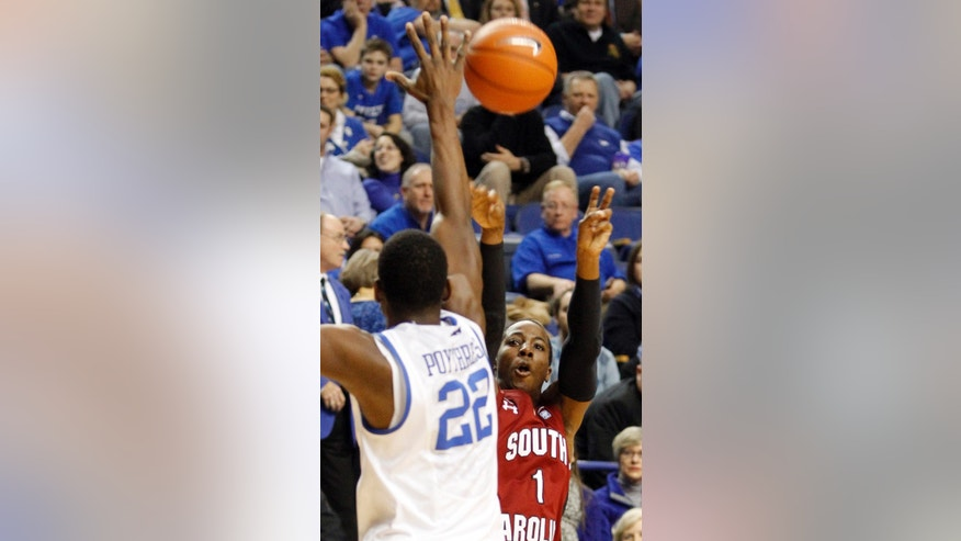 South Carolina's Brenton Williams (1) shoots under pressure from Kentucky's Alex Poythress (22) during the first half of an NCAA college basketball game at Rupp Arena in Lexington, Ky., Tuesday, Feb. 5, 2013. (AP Photo/James Crisp)