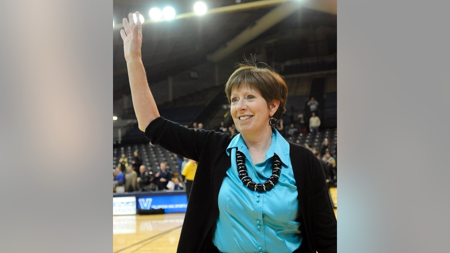 Notre Dame coach Muffet McGraw waves to the crowd after their 59-52 win over Villanova in an NCAA college basketball game against Villanova, Tuesday, Feb. 5, 2013, in Villanova, Pa. McGraw earned her 700th coaching victory with the win. (AP Photo/Michael Perez)