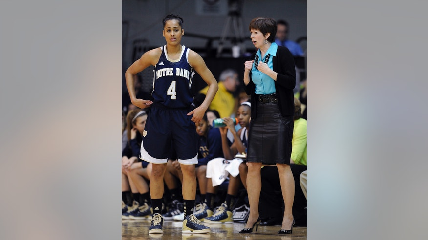 Notre Dame coach Muffet McGraw, right, talks to Skylar Diggins during a break in play in the first half of an NCAA college basketball game against Villanova, Tuesday, Feb. 5, 2013, in Villanova, Pa.  (AP Photo/Michael Perez)