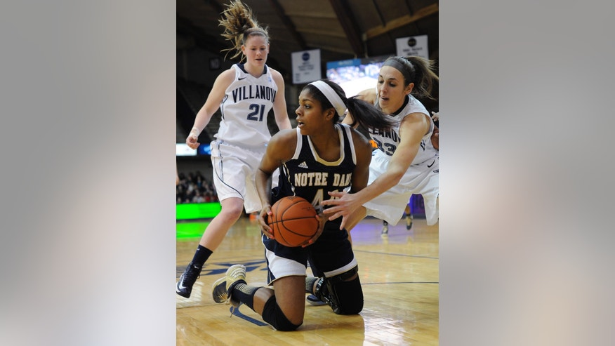 Notre Dame's Ariel Baker (44) grabs a loose ball in front of Villanova's Laura Sweeney (33) and Lauren Burford (21) during the first half of an NCAA college basketball game, Tuesday, Feb. 5, 2013, in Villanova, Pa.  (AP Photo/Michael Perez)