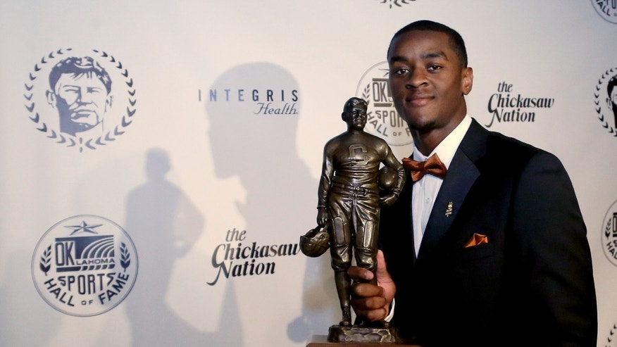 Mississippi State's Johnthan Banks poses with the Jim Thorpe Award in Oklahoma City, Tuesday, Feb. 5, 2013. Banks was presented the award on Tuesday as college football's best defensive back. (AP Photo/Sue Ogrocki)