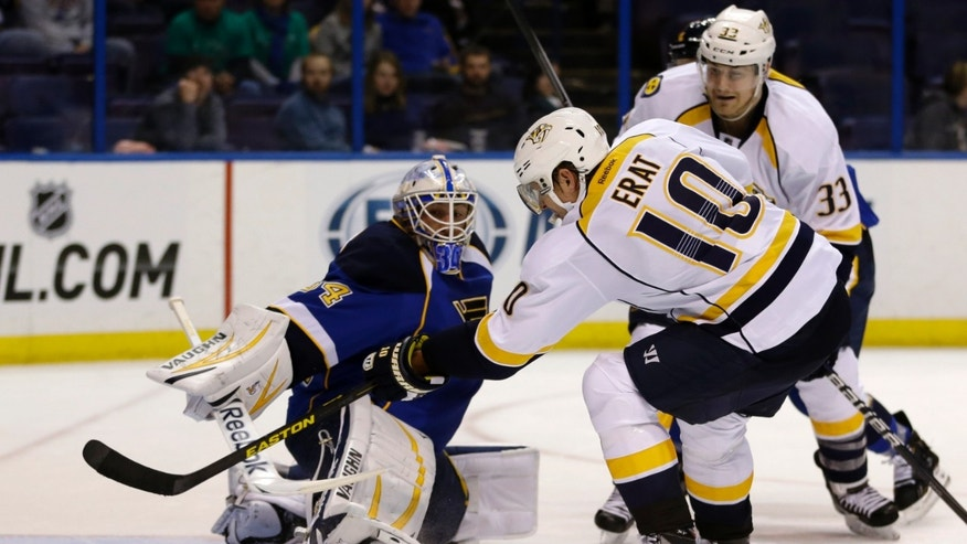 Nashville Predators' Martin Erat, of the Czech Republic, scores past St. Louis Blues goalie Jake Allen, left, as Predators' Colin Wilson watches during the third period of an NHL hockey game Tuesday, Feb. 5, 2013, in St. Louis. The Predators won 6-1. (AP Photo/Jeff Roberson)