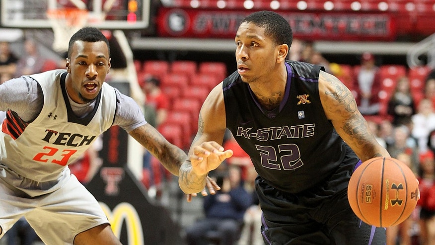 Kansas State's Rodney McGruder drives against Texas Tech's Jamal Williams during an NCAA college basketball game in Lubbock, Texas, Tuesday, Feb. 5, 2013. (AP Photo/Lubbock Avalanche-Journal,Zach Long)