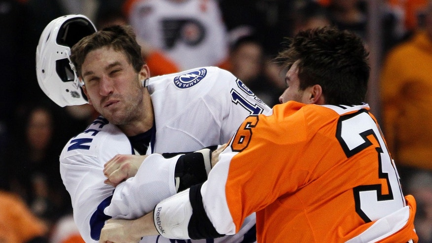 Philadelphia Flyers' Zac Rinaldo, right, lands a punch that knocks the helmet off of Tampa Bay Lightning' B.J. Crombeen during a fight in the first period of an NHL hockey game, Tuesday, Feb. 5, 2013, in Philadelphia. (AP Photo/Tom Mihalek)