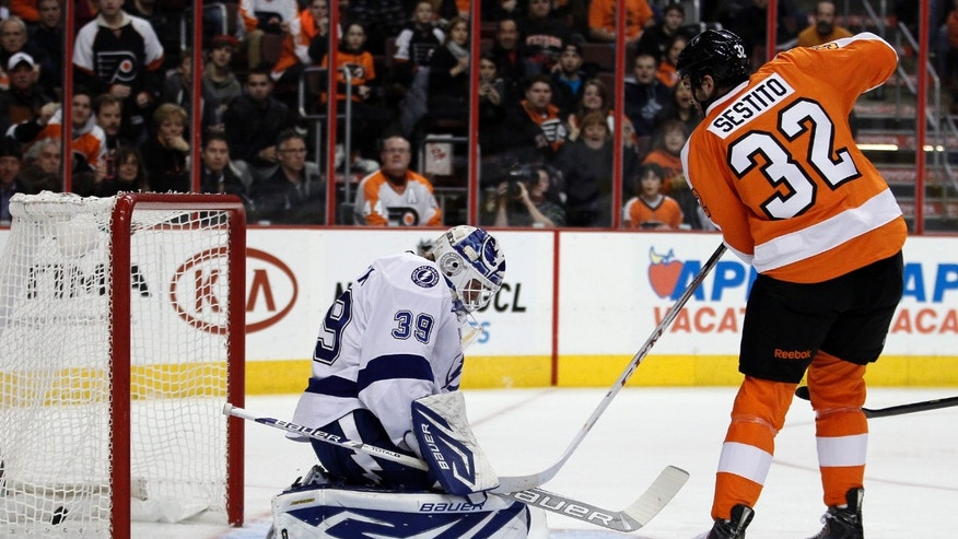 Philadelphia Flyers' Tom Sestito getrs the puck past Tampa Bay Lightning goalie Anders Lindback for a goal in the second period of an NHL hockey game, Tuesday, Feb. 5, 2013, in Philadelphia. (AP Photo/Tom Mihalek)