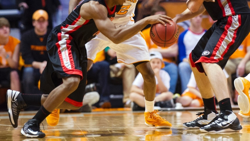 Tennessee guard Jordan McRae (52) defends against Georgia guard Kenny Gaines (12) during the first half of an NCAA college basketball game, Wednesday, Feb. 6, 2013, in Knoxville, Tenn. (AP Photo/The Knoxville News Sentinel, Adam Brimer)