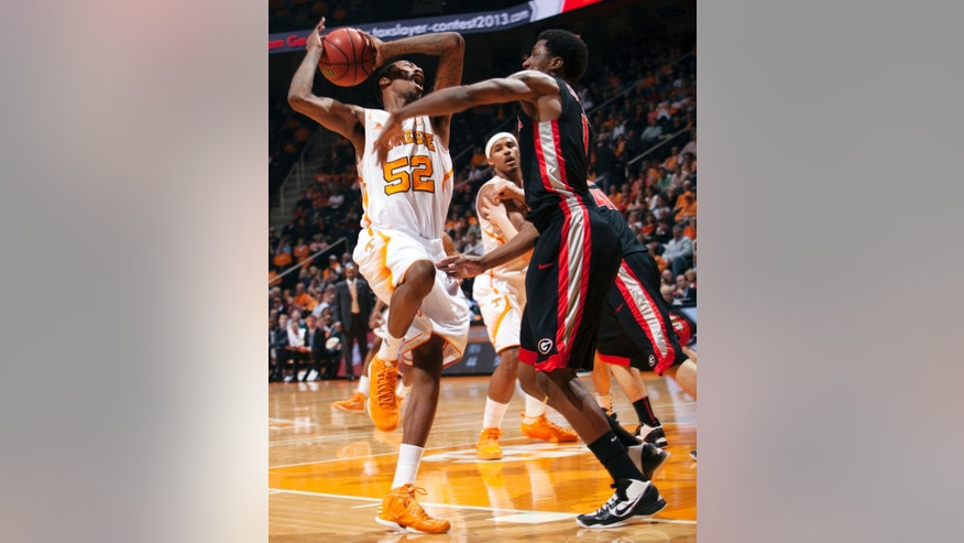 Tennessee guard Jordan McRae (52) shoots as Georgia guard Kentavious Caldwell-Pope (1) defends during the first half of an NCAA college basketball game, Wednesday, Feb. 6, 2013, in Knoxville, Tenn. (AP Photo/The Knoxville News Sentinel, Adam Brimer)