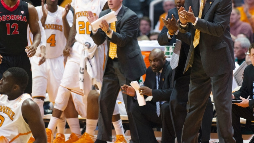 Tennessee head coach Cuonzo Martin cheers after a foul was called on Georgia during the first half of an NCAA college basketball game, Wednesday, Feb. 6, 2013, in Knoxville, Tenn. (AP Photo/The Knoxville News Sentinel, Adam Brimer)