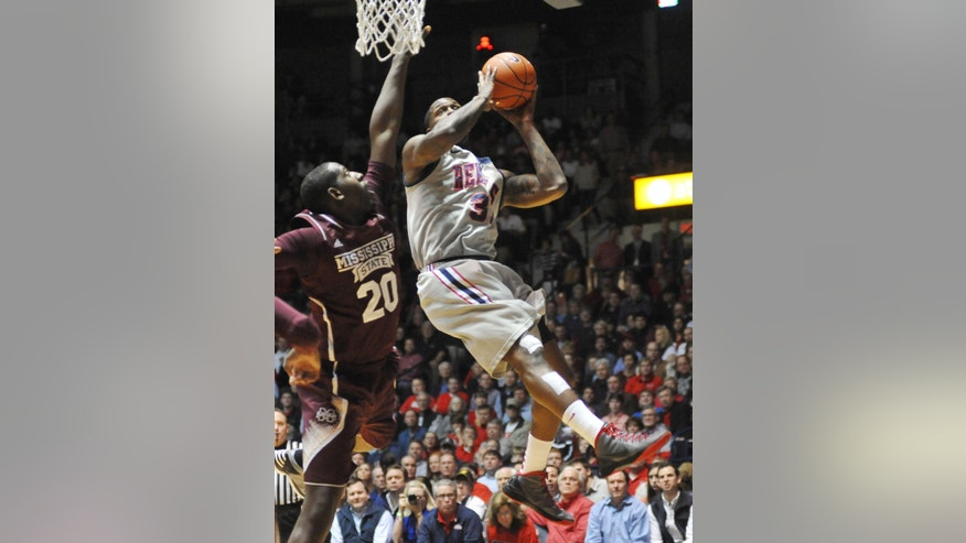 Mississippi's Murphy Holloway (31) is fouled by Mississippi State's Gavin Ware (20) during an NCAA college basketball game Wednesday, Feb. 6, 2013, in Oxford, Miss. (AP Photo/Oxford Eagle, Bruce Newman) MANDATORY CREDIT  MAGS OUT  NO SALES