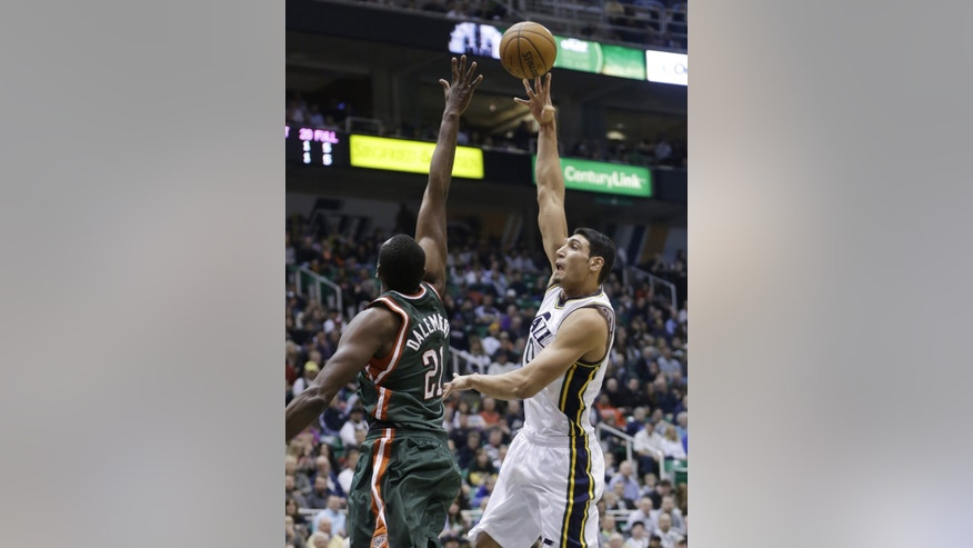 Utah Jazz's Enes Kanter (0) shoots as Milwaukee Bucks' Samuel Dalembert (21) defends in the second quarter during an NBA basketball game on Wednesday, Feb. 6, 2013, in Salt Lake City. (AP Photo/Rick Bowmer)