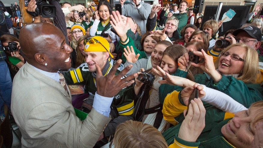 Green Packers all time leading receiver, Donlad Driver, greets fans after his retirement ceremony Wednesday, Feb. 6, 2013 at Lambeau Field in Green Bay, Wis. (AP Photo/Mike Roemer)