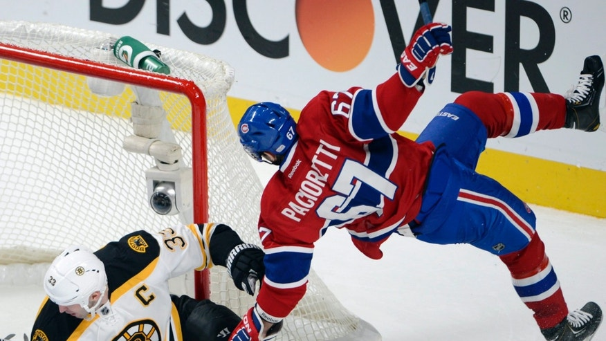 Montreal Canadiens left wing Max Pacioretty (67) is upended by Boston Bruins defenseman Zdeno Chara (33) during the second period of their NHL hockey game, Wednesday, Feb. 6, 2013, in Montreal. (AP Photo/The Canadian Press, Ryan Remiorz)