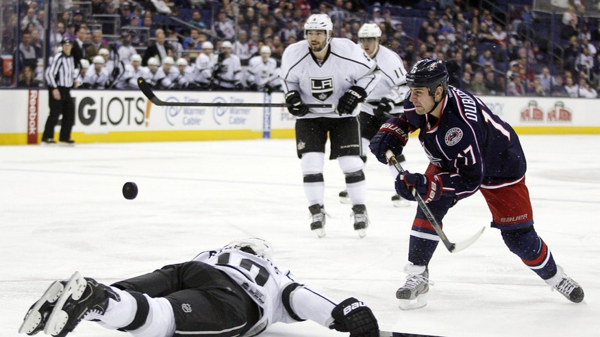 Columbus Blue Jackets' Brandon Dubinsky (17) has his shot blocked by a diving Los Angeles Kings' Mike Ruchards (10) during the second period of an NHL hockey game, Tuesday, Feb. 5, 2013, in Columbus, Ohio. (AP Photo/ Mike Munden)
