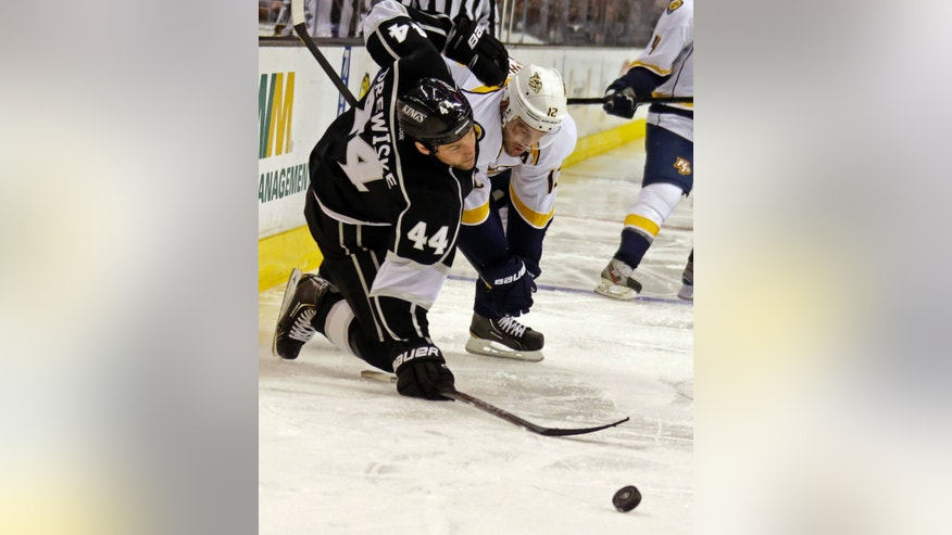 Nashville Predators center Mike Fisher (12) and Los Angeles Kings defenseman Davis Drewiske (44) go for the puck in the third period of an NHL hockey game in Los Angeles, Thursday, Jan. 31, 2013. Tied 1-1 in regulation and overtime, the Predators won in a shootout, 2-1. (AP Photo/Reed Saxon)