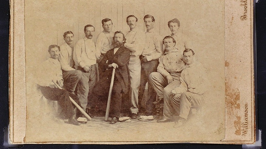 This undated file photo released by the Saco River Auction Co., in Biddeford, Maine, shows a rare 1865 baseball card of the Brooklyn Atlantics, discovered in a photo album bought at a yard sale in Baileyville, Maine, on the Canadian border.