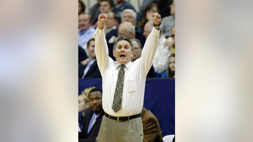 In this photo taken Feb. 5, 2013, Akron head coach Keith Dambrot yells to his players in an NCAA college basketball game against Central Michigan in Akron, Ohio. With the nation's longest winning streak, a dominant center with NBA potential, the fiery Dambrot and LeBron James as a supporter, Akron could become the next mid-major to make a deep run in the NCAA tournament. (AP Photo/Mark Duncan)