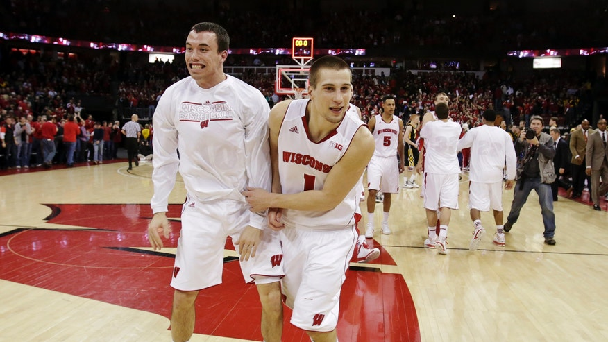Wisconsin's Dan Fahey, left, and Ben Brust (1) celebrate their 74-70 win over Iowa in double overtime of their NCAA college basketball game, Wednesday, Feb. 6, 2013, in Madison, Wis. (AP Photo/Andy Manis)