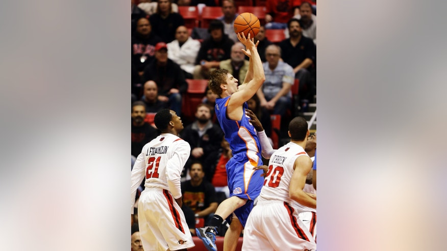 Boise State's Anthony Drmic shoots against San Diego State's Jamaal Franklin (21) and JJ O'Brien (20) during the first half of an NCAA college basketball game, Wednesday, Feb. 6, 2013, in San Diego. (AP Photo/Lenny Ignelzi)