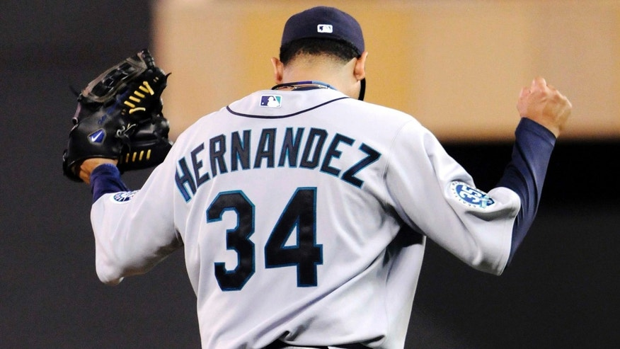 Monday, Aug. 27, 2012: Seattle Mariners pitcher Felix Hernandez celebrates the final out as he shut out the Minnesota Twins 1-0 in a baseball game in Minneapolis.