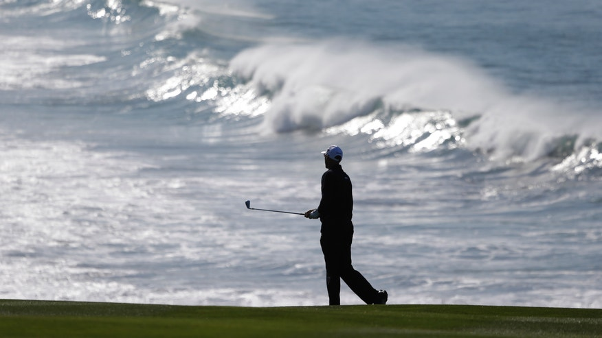 Cameron Percy of Australia follows his shot from the fairway to the ninth green of the Pebble Beach Golf Links during a practice round of the AT&T Pebble Beach Pro-Am golf tournament Wednesday, Feb. 6, 2013 in Pebble Beach, Calif. (AP Photo/Eric Risberg)