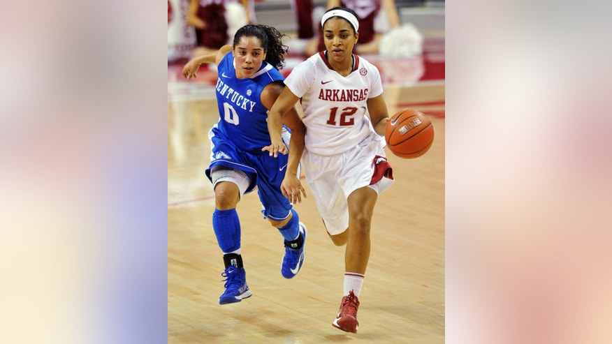 Arkansas guard Dominique Wilson (12) tries to get the ball past Kentucky's Jennifer O'Neill during the first half of their NCAA college basketball game, Thursday, Feb. 7, 2013, in Fayetteville, Ark. Kentucky won 80-74 in overtime. (AP Photo/The Northwest Arkansas Times, Michael Woods)  ARKANSAS OUT