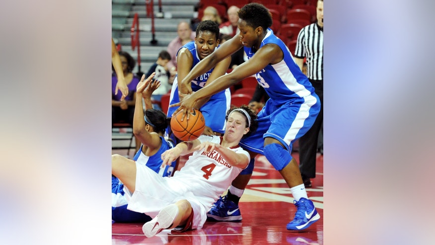 Arkansas' Sarah Watkins (4) and Kentucky's, from left, Bria Goss, Brittany Henderson and Samarie Walker fight for a rebound during overtime of their NCAA college basketball game, Thursday, Feb. 7, 2013, in Fayetteville, Ark. Kentucky won 80-74 in overtime. (AP Photo/The Northwest Arkansas Times, Michael Woods)  ARKANSAS OUT