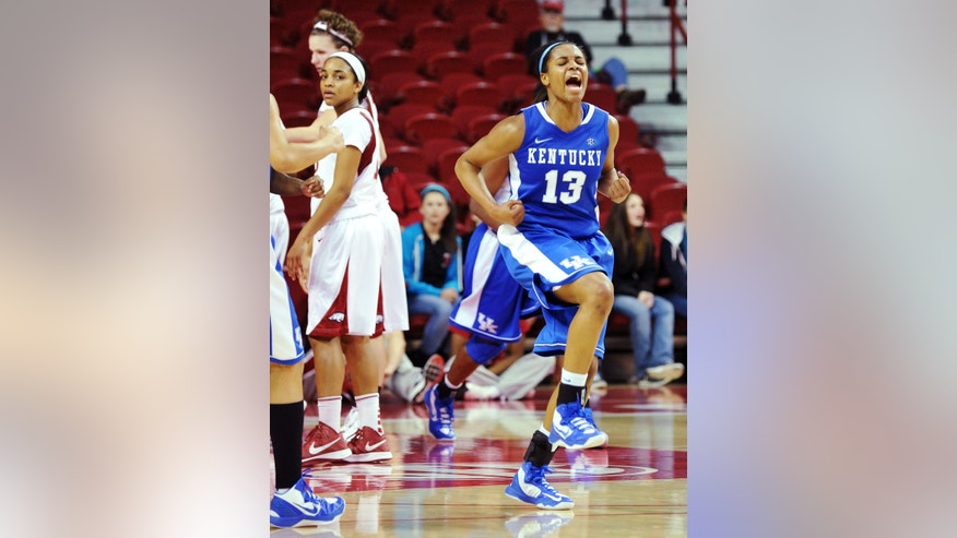 Kentucky's Bria Goss (13) reacts after scoring against Arkansas during overtime of their NCAA college basketball game, Thursday, Feb. 7, 2013, in Fayetteville, Ark. Kentucky won 80-74 in overtime. (AP Photo/The Northwest Arkansas Times, Michael Woods)  ARKANSAS OUT