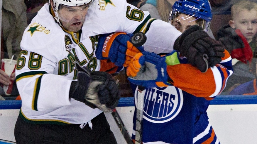 Dallas Stars' Jaromir Jagr, left, vies for the puck with Edmonton Oilers' Mark Arcobello during the first period of an NHL hockey game Wednesday, Feb. 6, 2013, in Edmonton, Alberta. (AP Photo/The Canadian Press, John Franson)