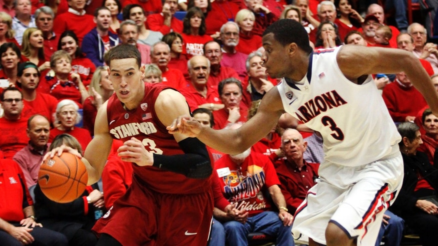 Stanford's Dwight Powell (33) drives to the basket around Arizona's Kevin Parrom (3) during the first half of an NCAA college basketball game at McKale Center in Tucson, Ariz., Wednesday, Feb. 6, 2013. (AP Photo/Wily Low)