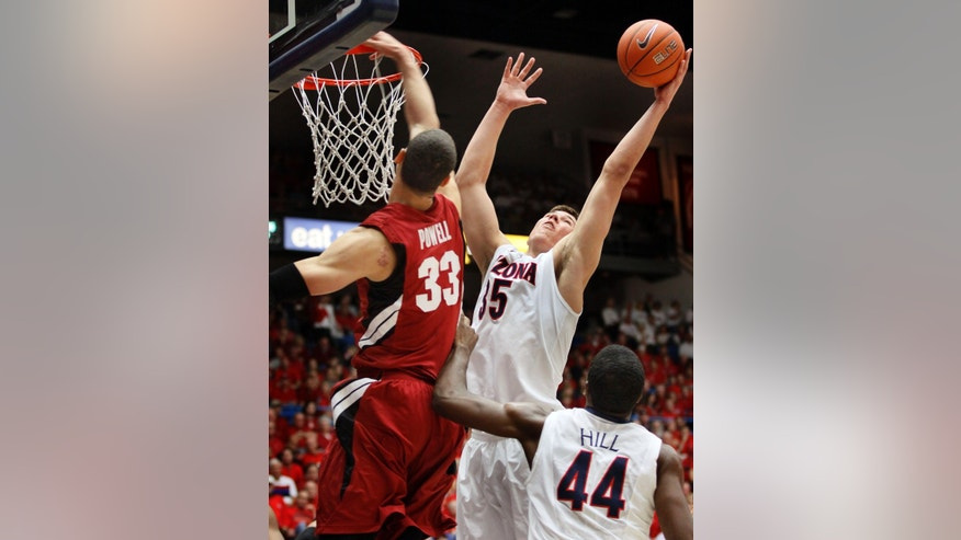 Arizona's Kaleb Tarczewski (35) grabs the rebound from Stanford's Dwight Powell (33) as Arizona's Solomon Hill watches during the first half of an NCAA college basketball game at McKale Center in Tucson, Ariz., Wednesday, Feb. 6, 2013. (AP Photo/Wily Low)