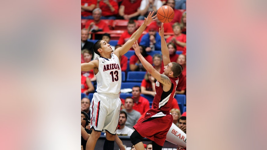 Arizona's Nick Johnson (13) blocks a shot by Stanford's Aaron Bright, right, during the first half of an NCAA college basketball game at McKale Center in Tucson, Ariz.,Wednesday, Feb. 6, 2013. (AP Photo/John Miller)