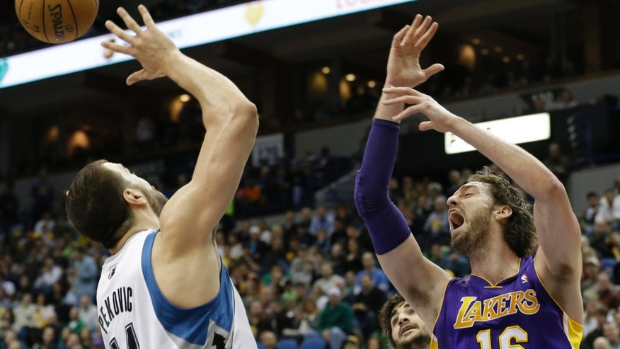 Los Angeles Lakers' Pau Gasol, of Spain, right, reacts as he and Minnesota Timberwolves' Nikola Pekovic of Montenegro miss in their attempt for the rebound in the third quarter of an NBA basketball game Friday, Feb. 1, 2013 in Minneapolis. Gasol led the Lakers with 22 points and had 12 rebounds as did Kobe Bryant in their 111-100 win. (AP Photo/Jim Mone)