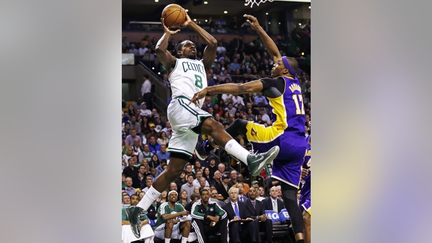 Boston Celtics forward Jeff Green (8) shoots over Los Angeles Lakers center Dwight Howard, right, during the first quarter of an NBA basketball game in Boston, Thursday, Feb. 7, 2013. (AP Photo/Charles Krupa)