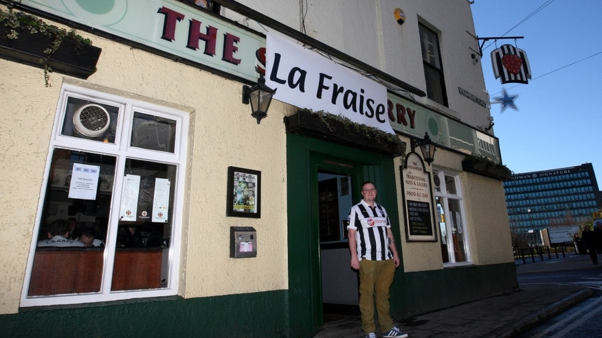 FILE - This Saturday, Feb. 2, 2013 file photo shows a general view of the Strawberry pub in Newcastle, England, which has put a French version of its name as a welcome to the new French players signed by Newcastle United. (AP Photo/Scott Heppell, File)