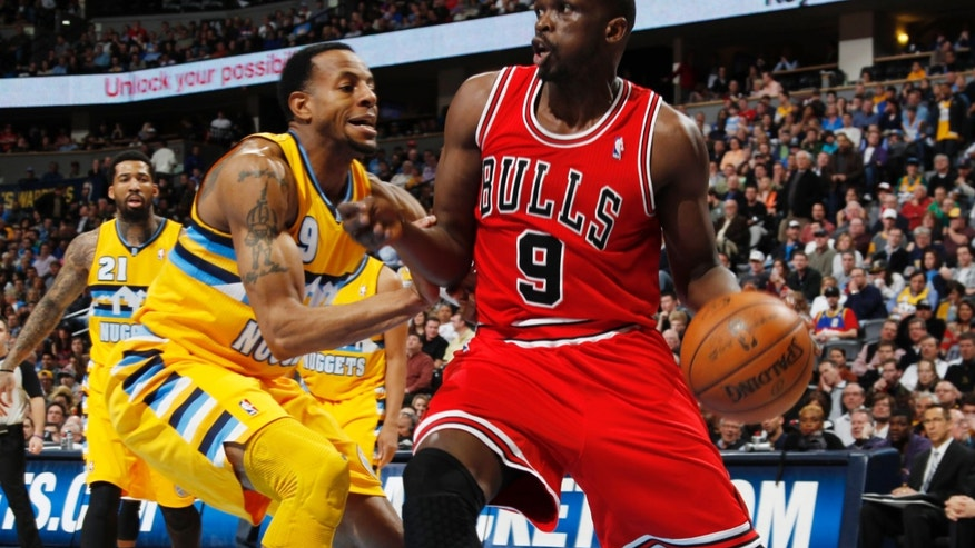 Chicago Bulls forward Luol Deng, right, of the Sudan, works ball inside against Denver Nuggets guard Andre Iguodala in the second quarter of an NBA basketball game in Denver on Thursday, Feb. 7, 2013. (AP Photo/David Zalubowski)