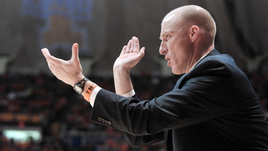 Illinois coach John Groce cheers on the Illini during the first half of an NCAA college basketball game at Assembly Hall in Champaign, Ill., on Thursday, Feb. 7, 2013. Illinois beat Indiana 74-72. (AP Photo/John Dixon)