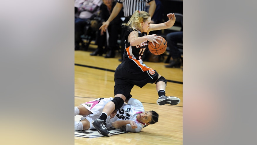 Oregon State's Jamie Weisner hurdles Colorado's Chucky Jeffery during the second half of an NCAA college basketball game Friday, Feb. 8, 2013, in Boulder, Colo. (AP Photo/Daily Camera, Cliff Grassmick) NO SALES  TV OUT